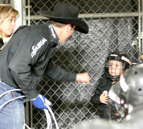 Getting a pep talk from a cowboy at the san antonio rodeo