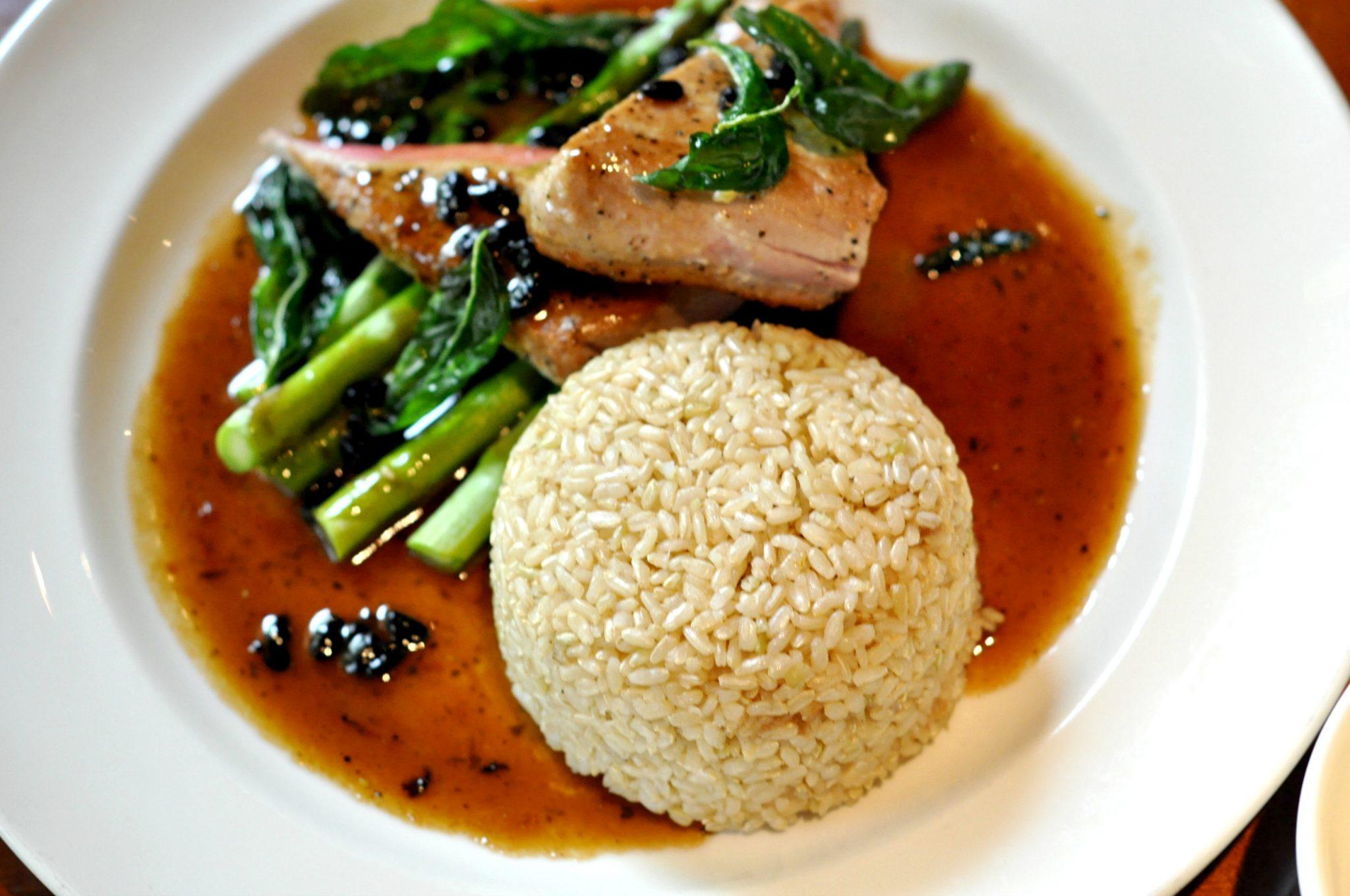 Yard House PAN SEARED AHI seared rare, asparagus, chinese black bean sauce, fried basil brown rice