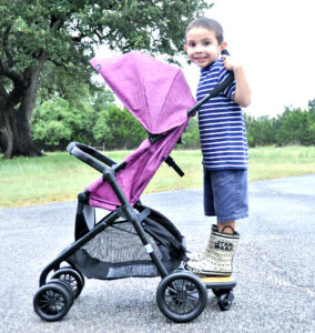 Riding the Evenflo Sibby Travel System Ride-Along Board for two