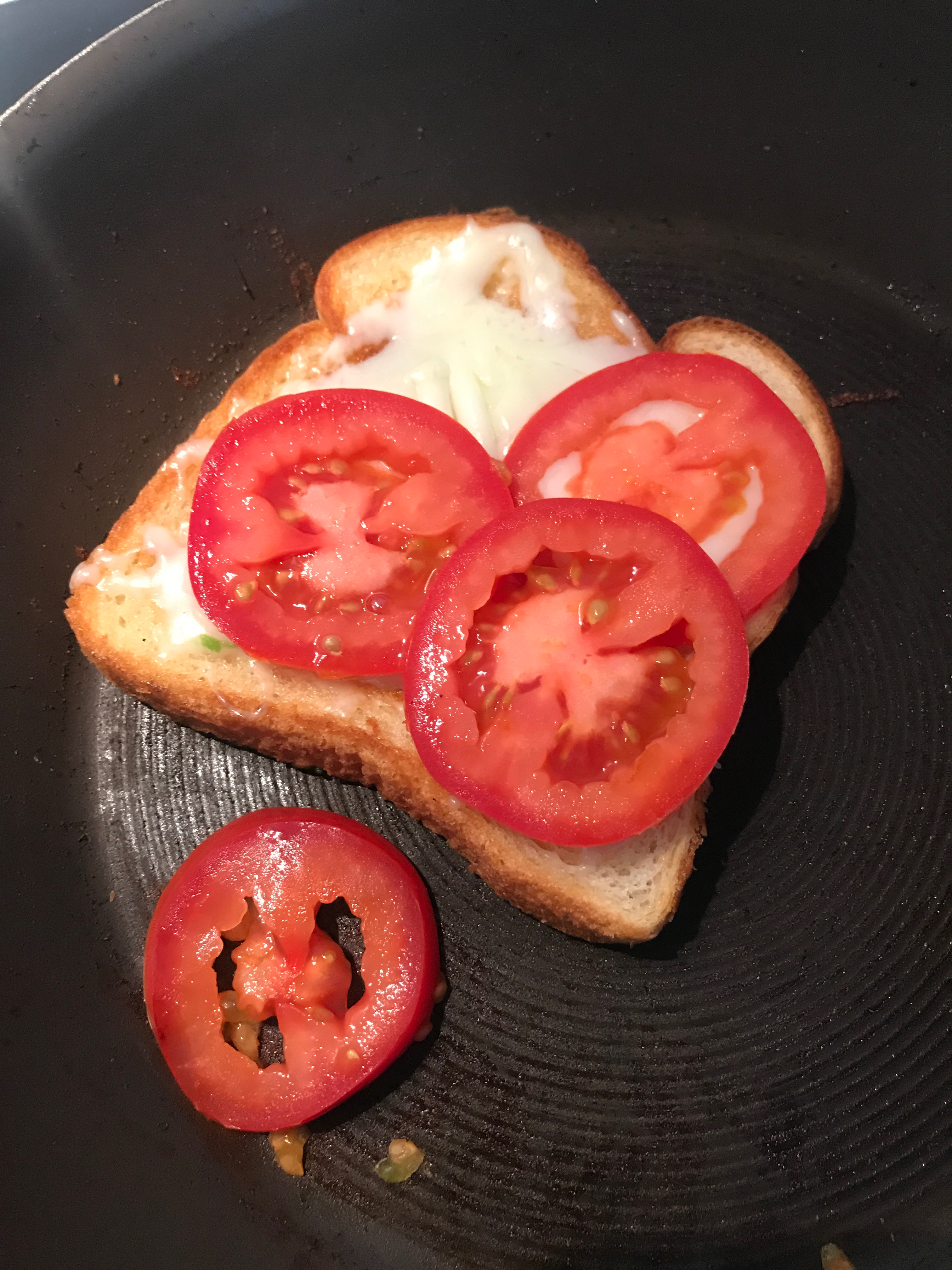 Grill tomatoes for the perfect tomato and avocado grilled cheese sandwich