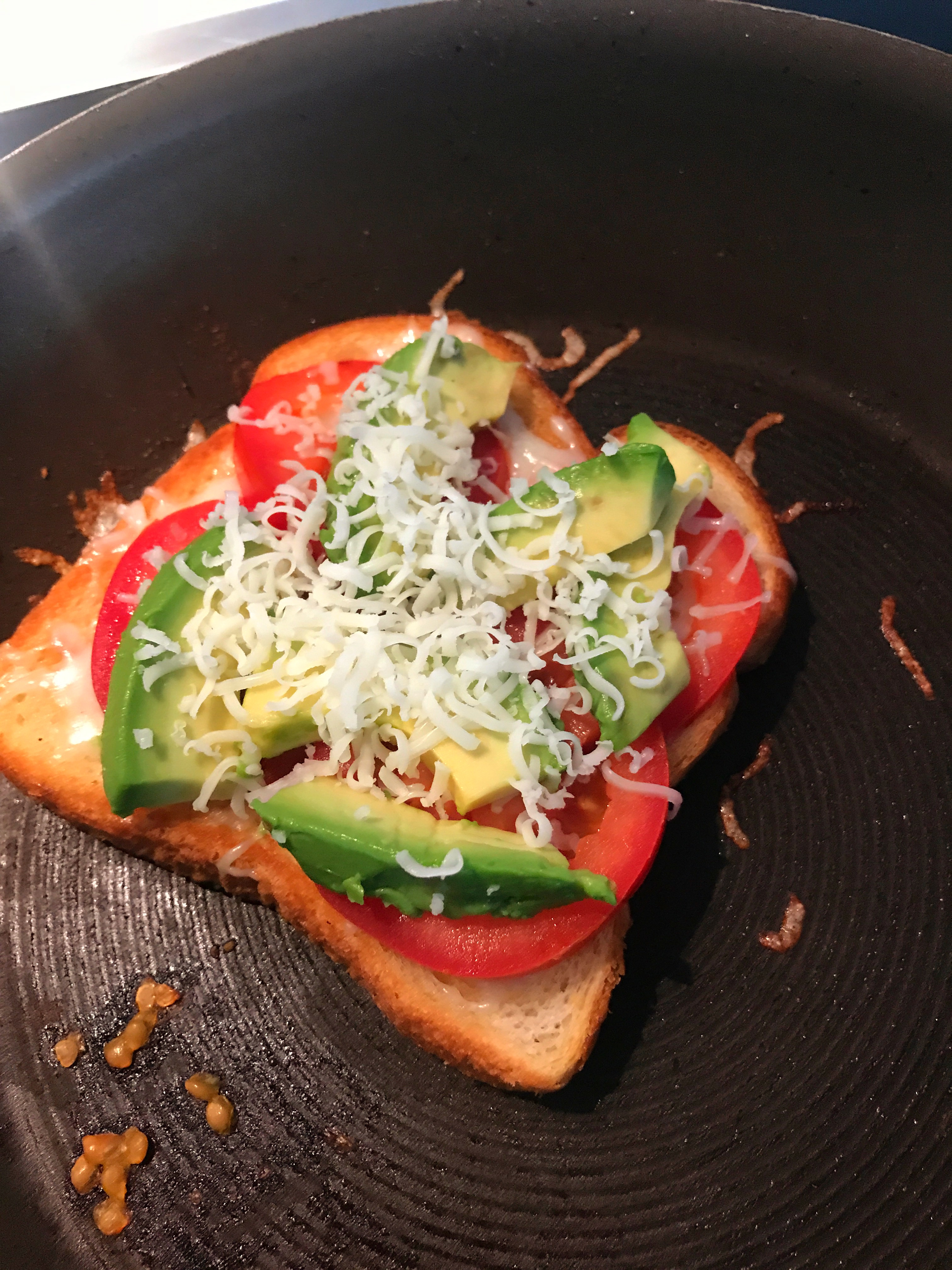 layer ingredients for the perfect tomato and avocado grilled cheese sandwich